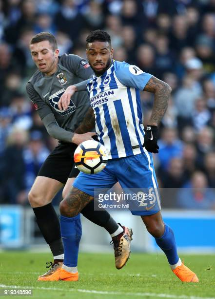Jurgen Locadia of Brighton and Hove Albion is challenged by Jordan Shipley of Coventry City during the The Emirates FA Cup Fifth Round between...