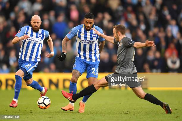Jurgen Locadia of Brighton and Hove Albion is challenged by Liam Kelly of Coventry City during the The Emirates FA Cup Fifth Round between Brighton...