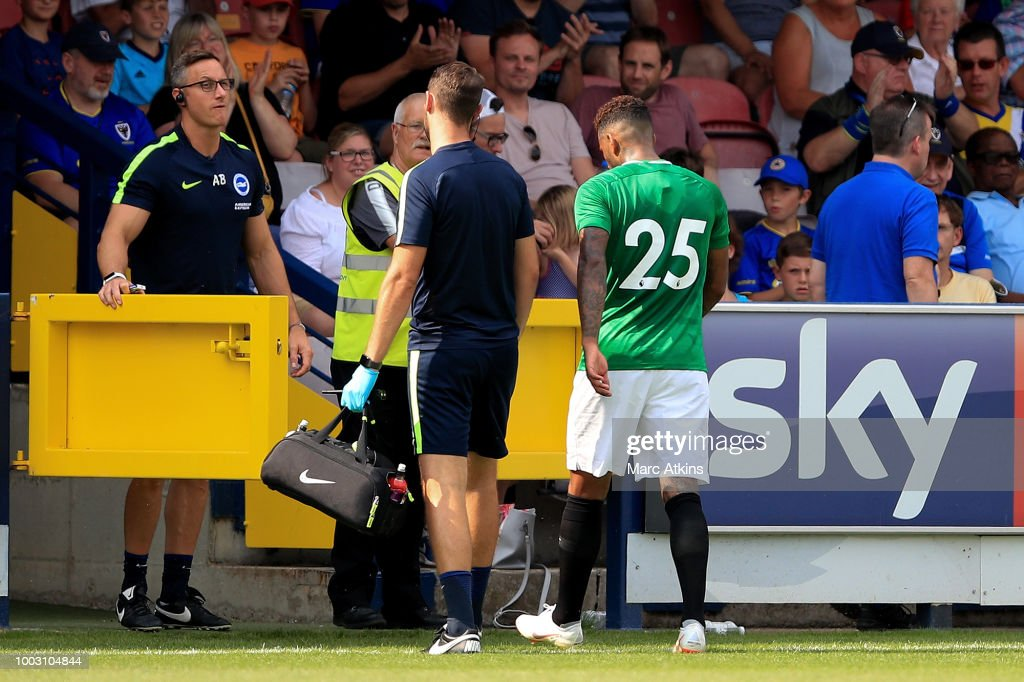 Jurgen Locadia of Brighton and Hove Albion leaves the game injured during the pre season friendly match between AFC Wimbledon and Brighton and Hove Albion at The Cherry Red Records Stadium on July 21, 2018 in Kingston upon Thames, England.