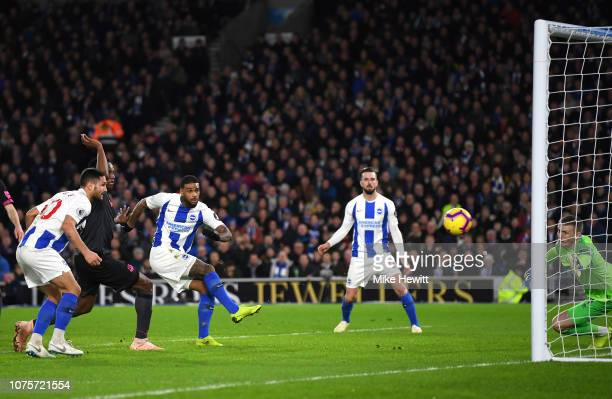 Jurgen Locadia of Brighton and Hove Albion scores his sides first goal during the Premier League match between Brighton Hove Albion and Everton FC at...
