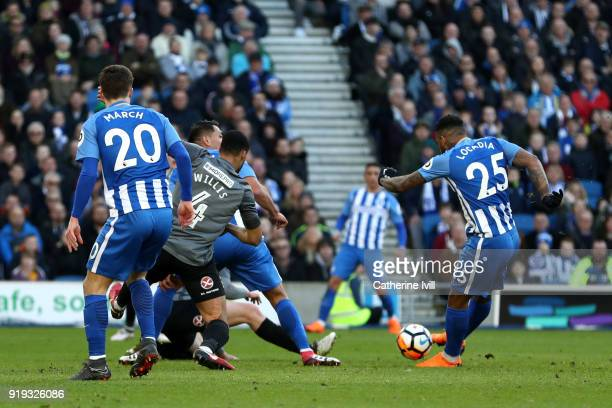 Jurgen Locadia of Brighton and Hove Albion scores his side's first goal during the The Emirates FA Cup Fifth Round between Brighton and Hove Albion v...