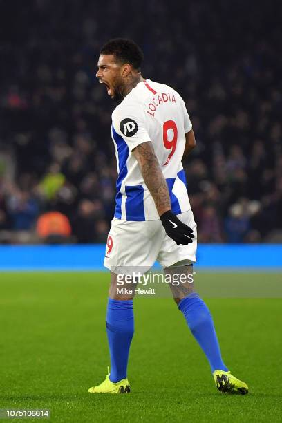 Jurgen Locadia of Brighton Hove Albion celebrates after scoring his team's first goal during the Premier League match between Brighton Hove Albion...