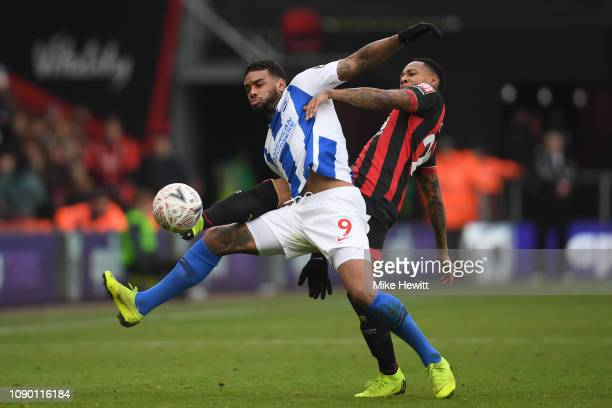 Jurgen Locadia of Brighton Hove Albion is challenged by debutant Nathaniel Clyne of Bournemouth during the FA Cup Third Round match between...