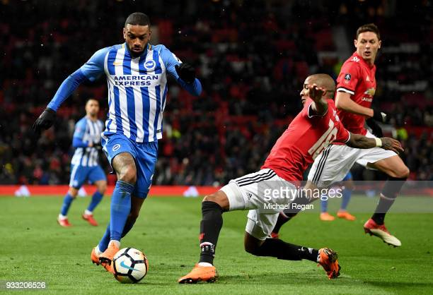 Jurgen Locadia of Brighton is challenged by Ashley Young of Manchester United during the Emirates FA Cup Quarter Final between Manchester United and...