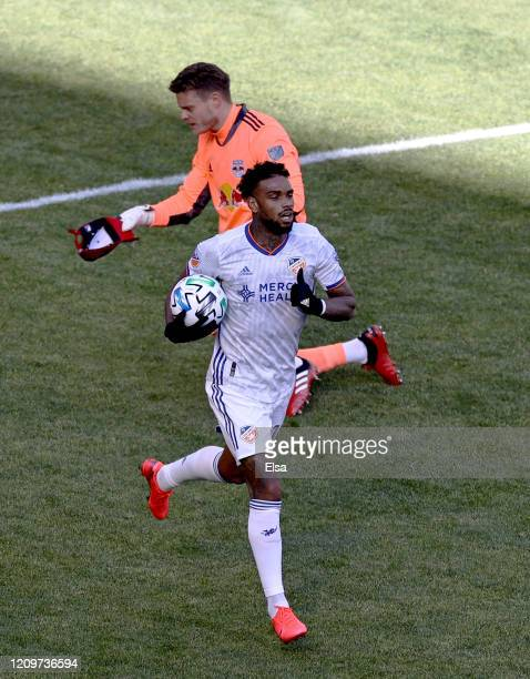Jurgen Locadia of FC Cincinnati celebrates his goal as David Jensen of New York Red Bulls reacts in the second half at Red Bull Arena on March 01,...