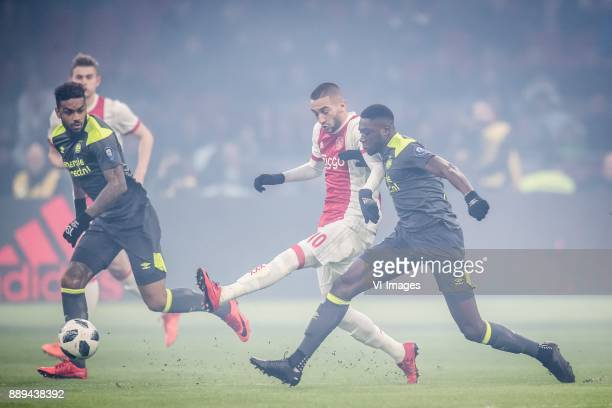 Jurgen Locadia of PSV Hakim Ziyech of Ajax Derrick Luckassen of PSV during the Dutch Eredivisie match between Ajax Amsterdam and PSV Eindhoven at the...