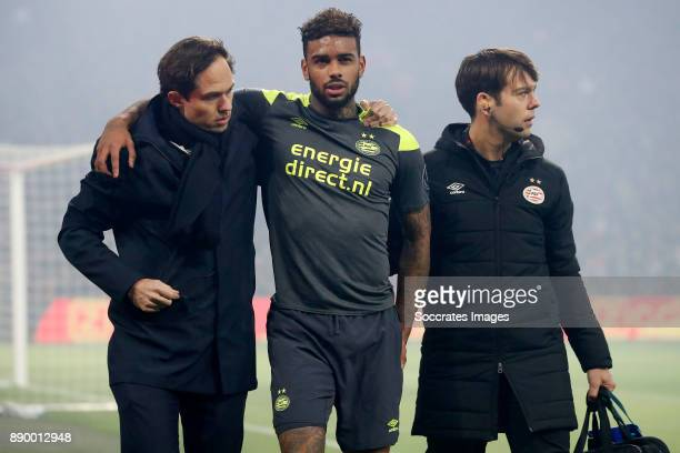 Jurgen Locadia of PSV is leaving the pitch injured during the Dutch Eredivisie match between Ajax v PSV at the Johan Cruijff Arena on December 10...
