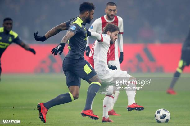 Jurgen Locadia of PSV Lasse Schone of Ajax during the Dutch Eredivisie match between Ajax v PSV at the Johan Cruijff Arena on December 10 2017 in...