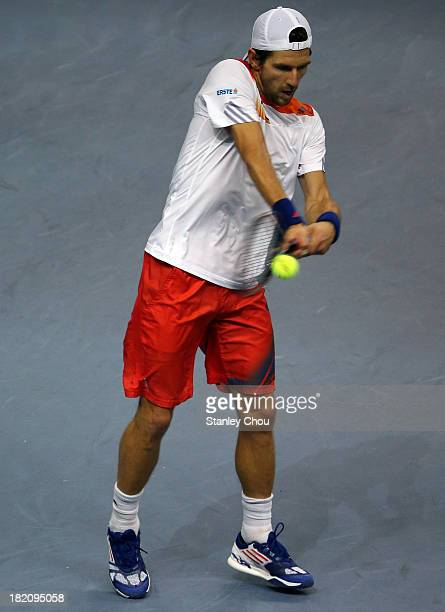 Jurgen Malzer of Austria plays a return shot against Joao Sousa of Portugal in the Singles Semi Finals during Day Six of the 2013 Malaysian Open at...