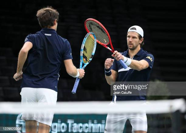 Jurgen Melzer of Austria and Edouard Roger-Vasselin of France celebrate during their semifinal on day 6 of the Rolex Paris Masters, an ATP Masters...