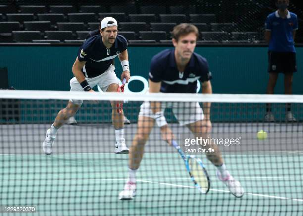 Jurgen Melzer of Austria and Edouard Roger-Vasselin of France in action during their semifinal on day 6 of the Rolex Paris Masters, an ATP Masters...
