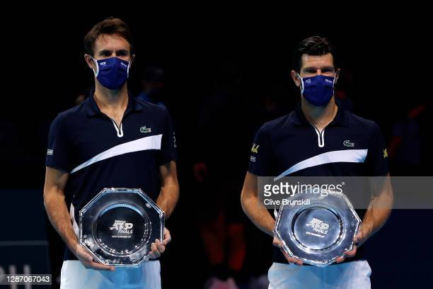 Jurgen Melzer of Austria and Edouard Roger-Vasselin of France pose with the runners up shields after losing the doubles final against Nikola Mektic...