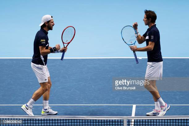 Jurgen Melzer of Austria and Edouard Roger-Vasselin of France celebrate winning a point during their doubles match against Mate Pavic of Croatia and...
