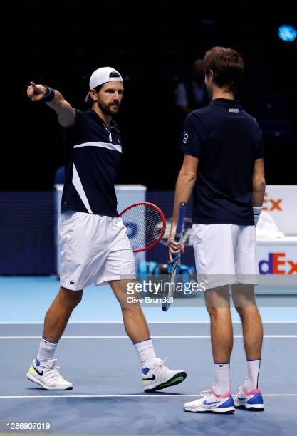 Jurgen Melzer of Austria and Edouard Roger-Vasselin of France celebrate winning match point in their doubles semi final match against Rajeev Ram of...