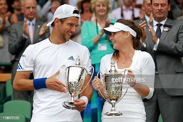 Jurgen Melzer of Austria and Iveta Benesova of the Czech Republic hold their championship trophy after winning their final round mixed doubles match...
