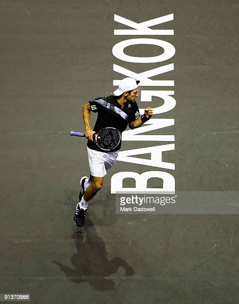 Jurgen Melzer of Austria celebrates a break point in his match against Gilles Simon of France during day eight of the 2009 Thailand Open at Impact...