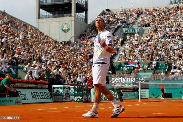 Jurgen Melzer of Austria celebrates during the men's singles quarter final match between Novak Djokovic of Serbia and Jurgen Melzer of Austria at the...