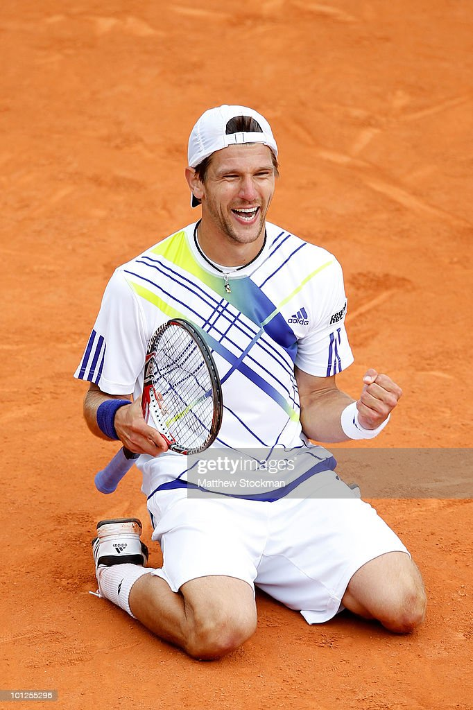 Jurgen Melzer of Austria celebrates match point during the men's singles third round match between David Ferrer of Spain and Jurgen Melzer of Austria on day seven of the French Open at Roland Garros on May 29, 2010 in Paris, France.