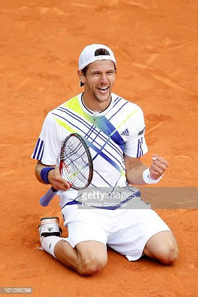 Jurgen Melzer of Austria celebrates match point during the men's singles third round match between David Ferrer of Spain and Jurgen Melzer of Austria...