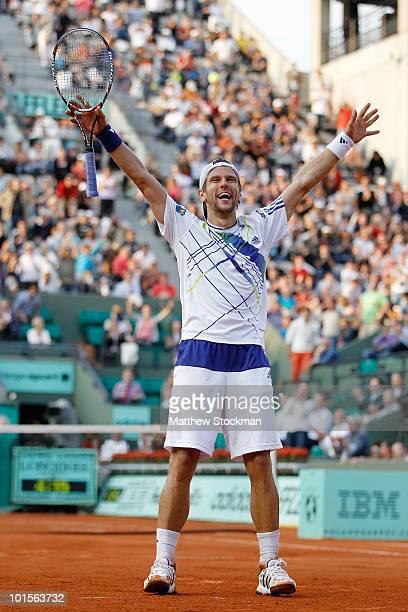 Jurgen Melzer of Austria celebrates winning the men's singles quarter final match between Novak Djokovic of Serbia and Jurgen Melzer of Austria at...