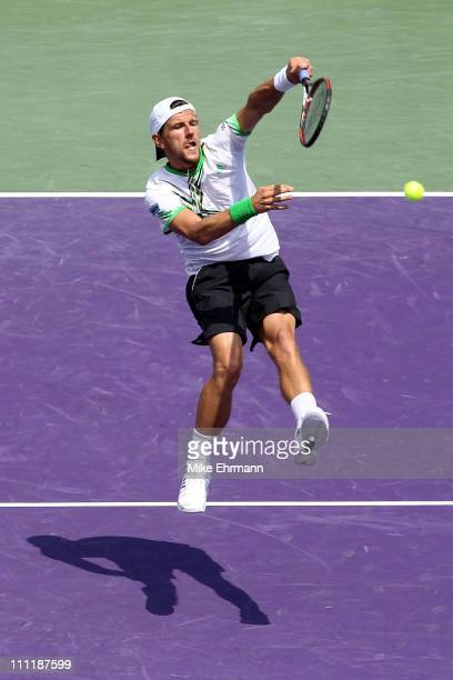 Jurgen Melzer of Austria hits a return against Jonathan Erlich of Israel and Andy Ram of Israel during their doubles match at the Sony Ericsson Open...