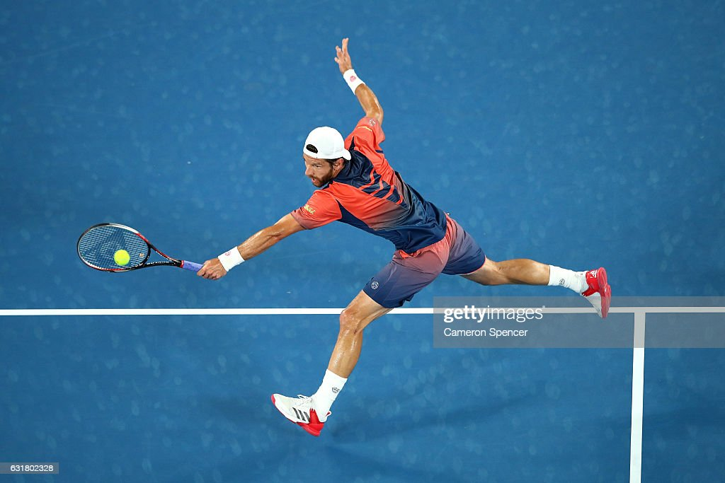 Jurgen Melzer of Austria plays a backhand in his first round match against Roger Federer of Switzerland on day one of the 2017 Australian Open at Melbourne Park on January 16, 2017 in Melbourne, Australia.