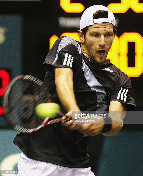 Jurgen Melzer of Austria plays a backhand return during his match against Andreas Beck of Germany during day seven of the 2009 Thailand Open at...