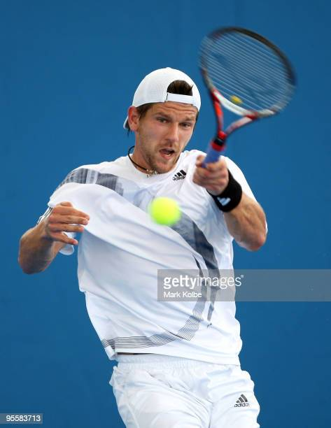 Jurgen Melzer of Austria plays a forehand during his first round match against Matthew Ebden of Australia during day three of the Brisbane...