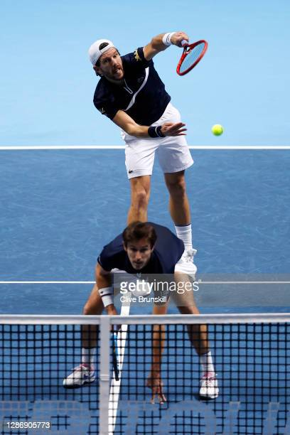 Jurgen Melzer of Austria plays a volley playing with partner Edouard Roger-Vasselin of France during their doubles semi final match against Rajeev...