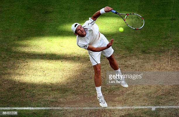 Jurgen Melzer of Austria serves during his quarterfinal match against Novak Djokovic of Serbia on day 5 of the Gerry Weber Open at the Gerry Weber...