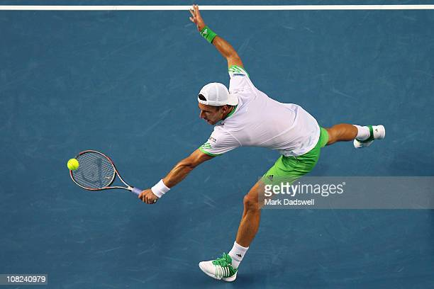 Jurgen Melzer of Austriaplays a backhand in his third round match against Marcos Baghdatis of Cyprus during day six of the 2011 Australian Open at...