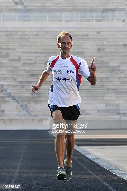 Jurgen Mennel a German ultramarathon runner finishes his run at the Panathenian marble stadium in Athens after running 2200 km from his home in...