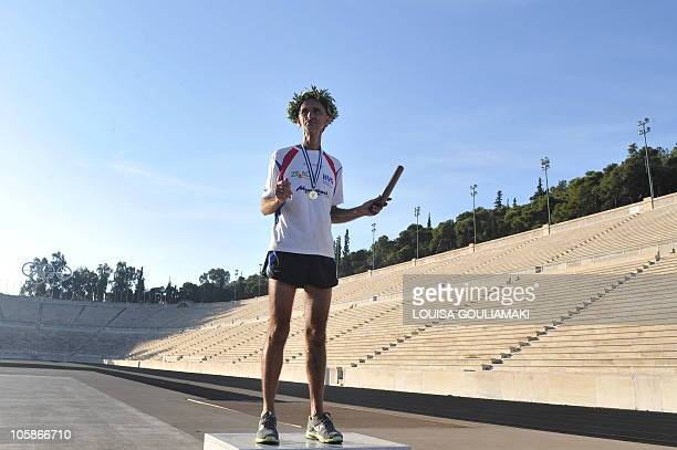 Jurgen Mennel a German ultramarathon runner poses at the Panathenian marble stadium in Athens after completing his 2200 km run from his home in...