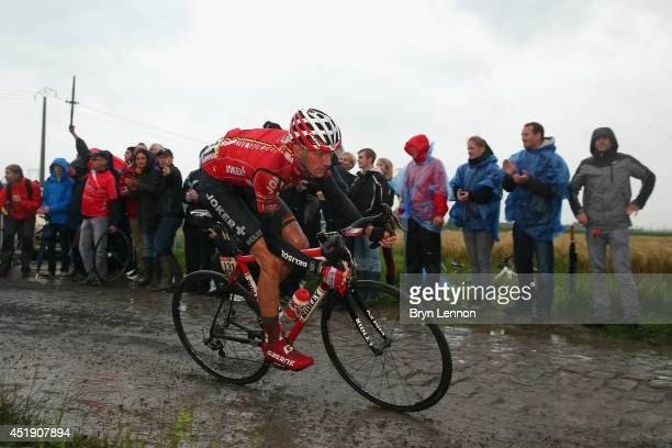Jurgen Van Den Broeck of Belgium and Team Lotto Belisol in action on the pave during the fifth stage of the 2014 Tour de France, a 155km stage...