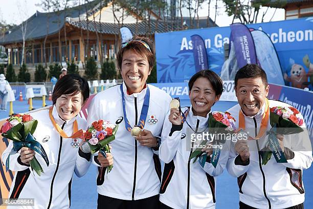 Juri Ide Yuichi Hosoda Ai Ueda and Hirokatsu Tayama pose for a picture after the Triathlon Men's Final in day six during the 2014 Asian Games at...