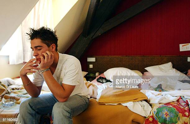 Cocchi Andrea an Italian student from the Primo Levi Technical Institute of Vignola in the Modena Province smokes a cigarette as he sits on his hotel...