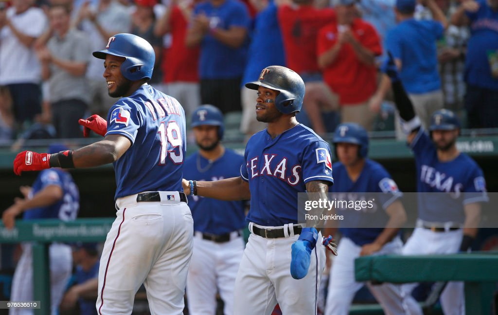 Jurickson Profar #19 and Delino DeShields #3 of the Texas Rangers celebrate with teammates after taking the lead over Colorado Rockies during the eighth inning at Globe Life Park in Arlington on June 16, 2018 in Arlington, Texas. The Rangers won 5-2.