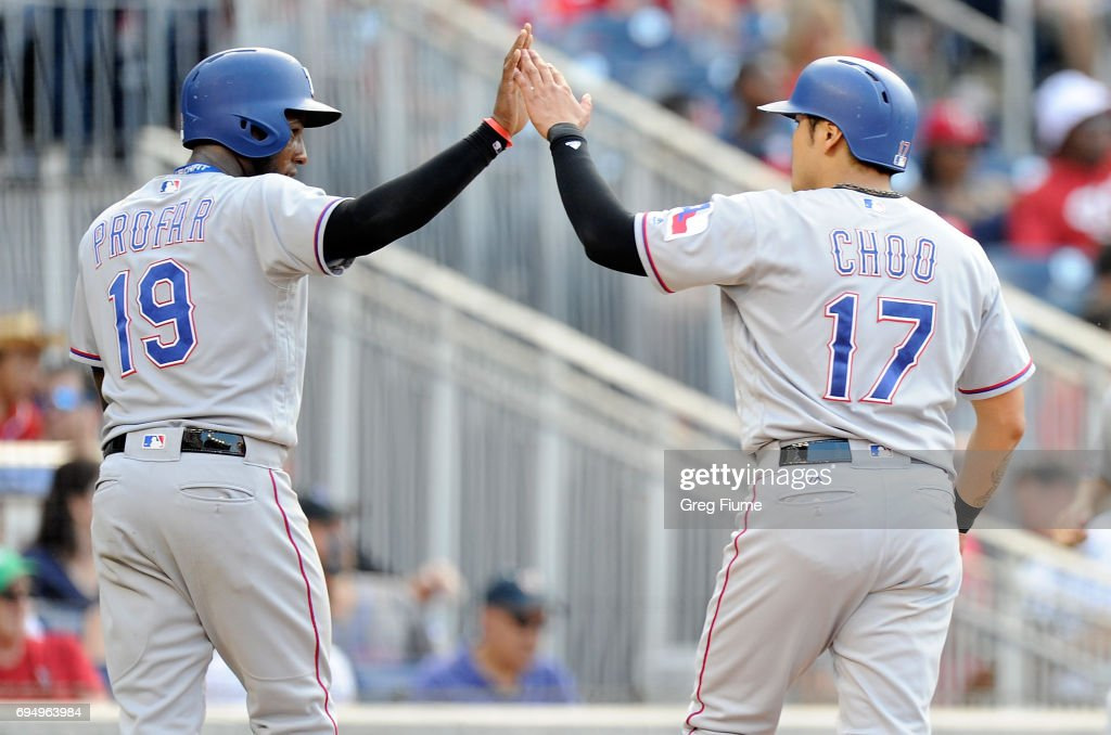 Jurickson Profar #19 and Shin-Soo Choo #17 of the Texas Rangers celebrate after scoring in the eighth inning against the Washington Nationals at Nationals Park on June 11, 2017 in Washington, DC. Texas won the game 5-1.