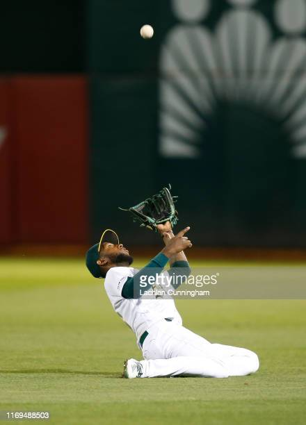 Jurickson Profar of the Oakland Athletics catches a pop up by Cameron Maybin of the New York Yankees in the top of the eighth inning at Ring Central...