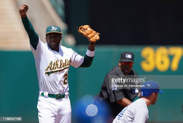 Jurickson Profar of the Oakland Athletics celebrates after tagging out Justin Smoak of the Toronto Blue Jays at second base in the top of the second...
