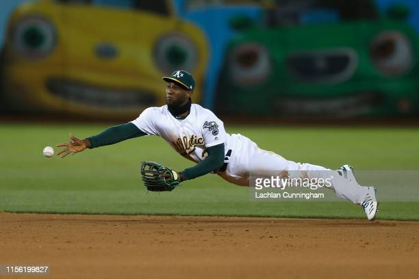 Jurickson Profar of the Oakland Athletics fields the ball and throws to second base to get the out of JP Crawford of the Seattle Mariners in the top...