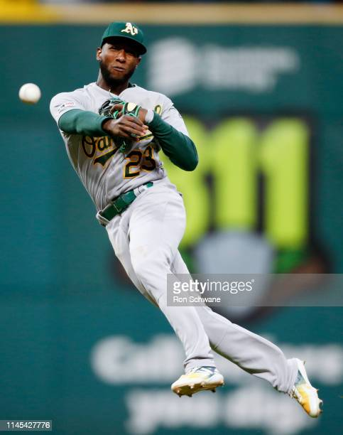 Jurickson Profar of the Oakland Athletics throws out Francisco Lindor of the Cleveland Indians at first base during the sixth inning at Progressive...