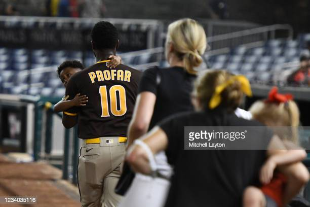Jurickson Profar of the San Diego Padres runs off the field with family after what was believed to be shots were heard during a baseball game between...