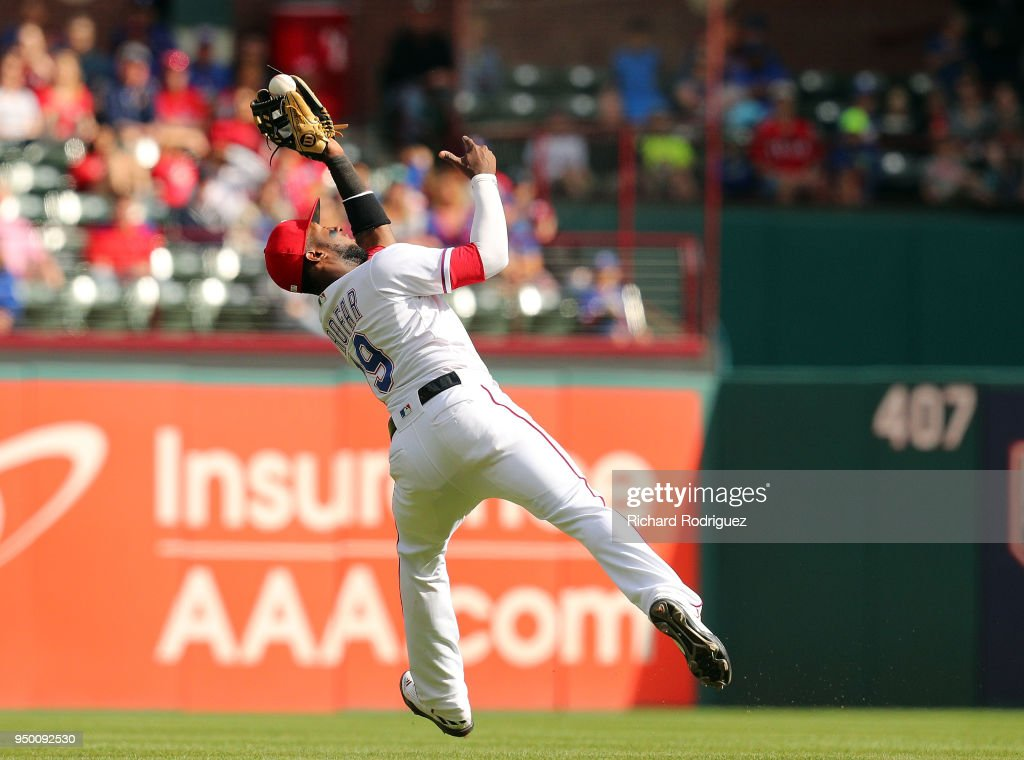 Jurickson Profar #19 of the Texas Rangers catches a fly ball by Dee Gordon of the Seattle Mariners for the final out of the 7-4 win at Globe Life Park in Arlington on April 22, 2018 in Arlington, Texas.