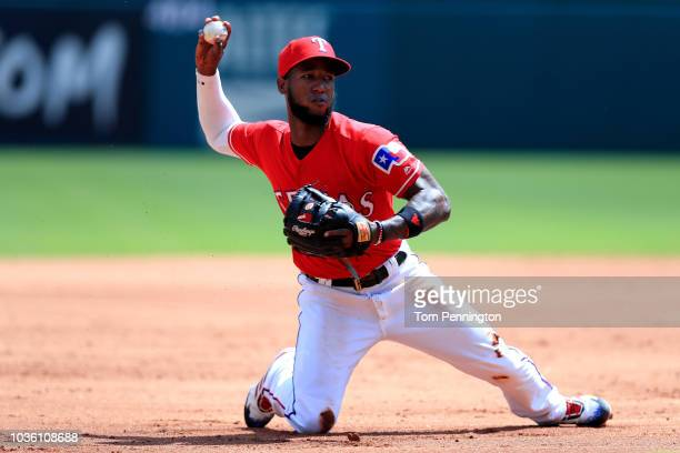 Jurickson Profar of the Texas Rangers fields a ground ball against the Tampa Bay Rays in the top of the second inning at Globe Life Park in Arlington...