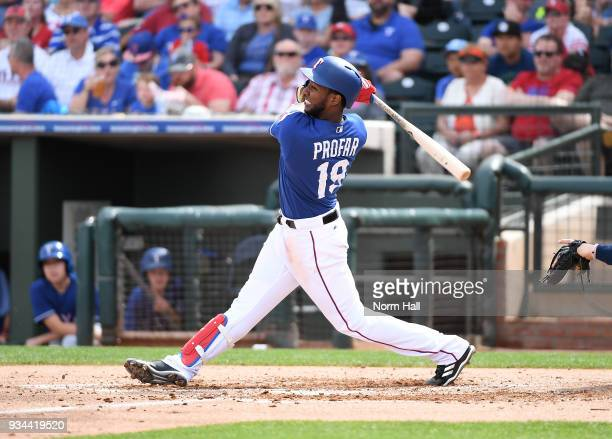 Jurickson Profar of the Texas Rangers follows through on a swing against the Seattle Mariners during a spring training game at Surprise Stadium on...