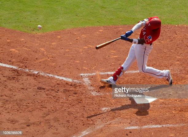 Jurickson Profar of the Texas Rangers hits a tworun home run in the sixth inning of a baseball game against the Minnesota Twins at Globe Life Park in...