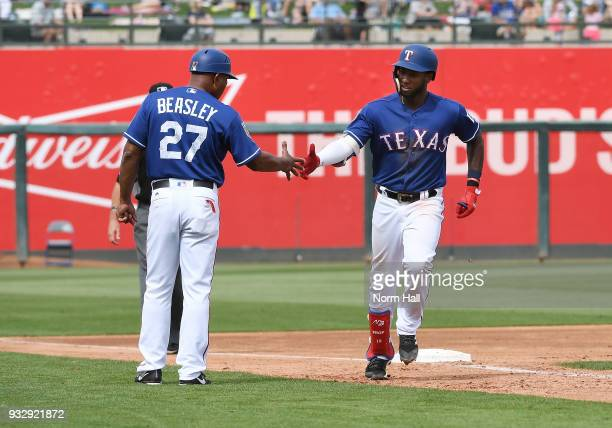 Jurickson Profar of the Texas Rangers is congratulated by third base coach Tony Beasley after hitting a two run home run during the third inning of a...