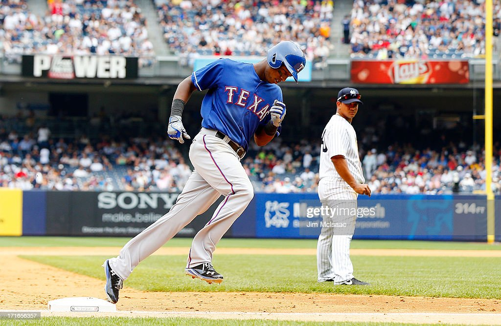 Jurickson Profar #13 of the Texas Rangers runs the bases after his fifth inning home run as Alberto Gonzalez #40 of the New York Yankees looks on at Yankee Stadium on June 27, 2013 in the Bronx borough of New York City.