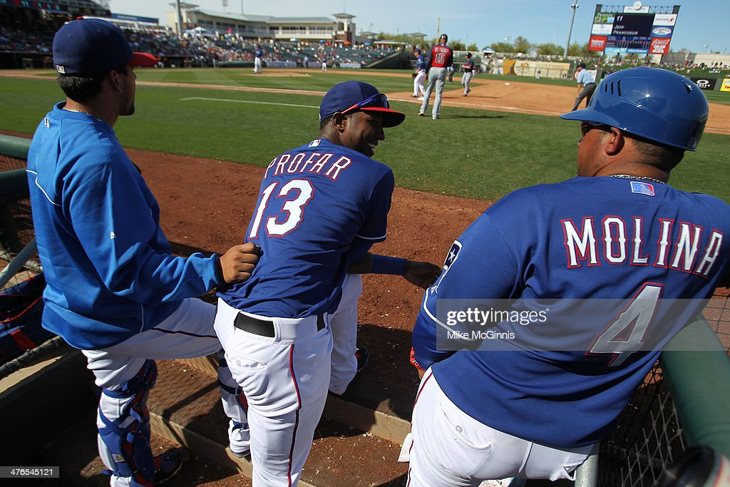 Jurickson Profar #13 of the Texas Rangers talks to first base coach Bengie Molina #4 during the bottom of the fifth inning against the Cleveland Indians at Surprise Stadium on March 03, 2014 in Surprise, Arizona.